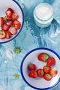 Fresh strawberries in the bowls with sugar Stock Photos