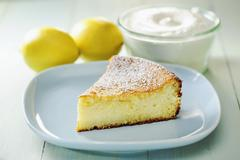 A slice of lemon and ricotta cheesecake Stock Photos