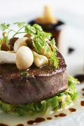 Beef medallion with mushrooms and chervil (close-up) Stock Photos