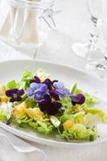 Salad leaves with oranges and edible flowers Stock Photos