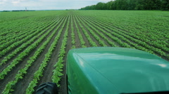 Tractor rides through the green Upolu. The view from the tractor cab Stock Footage