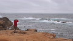 Point Lobos - Pacific Ocean Waves on Rocky Coastline with Photographer Stock Footage