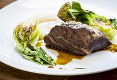 Beef cheek with pak choi and celery puree Stock Photos