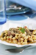 Pork cheeks with stewed beans Stock Photos