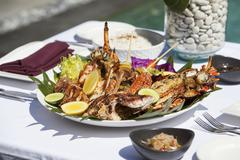 Fish and seafood platter on a table outdoors Stock Photos