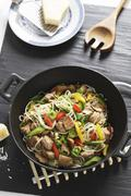 Fried noodles with pork, peppers and leek (Asia) Stock Photos