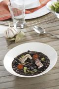 Black tolosa beans with chorizo, bacon and pig's ears (Spain) Stock Photos