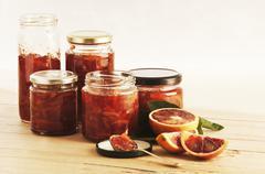 Several jars of blood orange & Campari marmalade Stock Photos