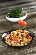 Chickpeas with tomatoes, octopus and mussels Stock Photos