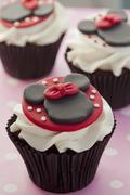Chocolate cupcake decorated with Minnie Mouse and buttercream Stock Photos