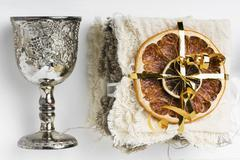 Dried fruits and a silver goblet as Christmas decorations Stock Photos