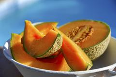 Cantaloupe melon, partly slices Stock Photos