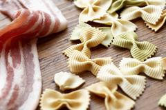 Uncooked Bacon and Tri-Color Bowtie Pasta Stock Photos