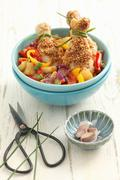 Chicken legs with sesame seeds, peppers and pineapple Stock Photos
