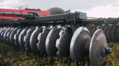 Stedicam shot: Agricultural machinery for cultivation of land. Moves in the Stock Footage