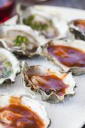 Barbecue Oysters and Fresh Oysters on the Half Shell Stock Photos