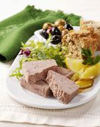 Ardennes pâté (meat paste, Belgium) with lettuce, bread and olives Stock Photos