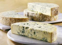 Several half moons of Stilton on marble boards Stock Photos