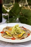 Carpaccio of suckling pig with spicy sweet and sour cabbage Stock Photos