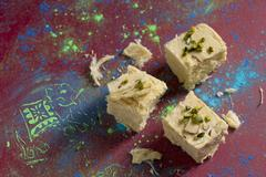 Soan papdi (sweet made from gram flour with almonds and pistachios, India) Stock Photos
