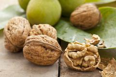 Walnuts (green, whole, shelled and cracked) Stock Photos