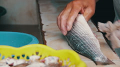 Gut fish. Cleans Fish. Fresh fish Processing Stock Footage