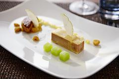 Foie gras with marinated apple Stock Photos