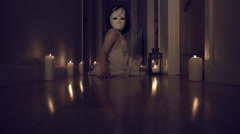 4k Thriller Shot in a Long Hall with Candles, Child with Mask turning to Camera Stock Footage