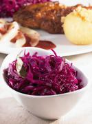 Red cabbage in a bowl as an accompaniment Stock Photos