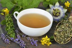 Herbal tea with ingredients (lemon balm, passion flower, St. John's wort, hops, Stock Photos