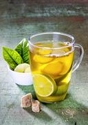 Ginger tea with limes in a glass cup Stock Photos