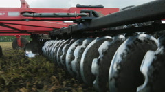 The mechanism for cultivating and plowing the land goes on the field Stock Footage
