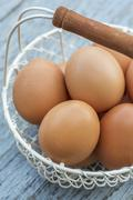 Brown Eggs in a Wire Basket Stock Photos