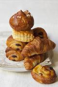 Croissants, puff pastry pinwheels, brioche and and apple turnover Stock Photos
