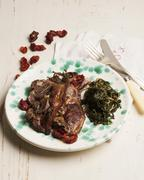 Lamb cooked in a casserole with herbs, tyme and dry tomatoe Stock Photos