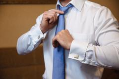 Business man fixing his tie. Elegant gentleman cloather Kuvituskuvat