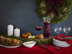 Holiday meal ready for serving with cornish game hens on a bed of green beans Stock Photos