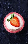 Daiquiri cupcake decorated with a strawberry and a sugared edge Stock Photos