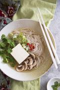 Noodle soup with tofu, mushrooms and coriander (Asia) Stock Photos