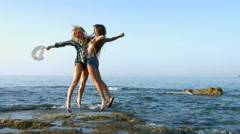 Two happy girls on the beach. 4K 30fps ProRes (HQ) Stock Footage