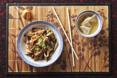Chinese pork and mushrooms with a bowl of wonton soup Stock Photos