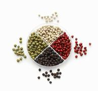 Bowl of Multi-Colored Peppercorns; Close Up Stock Photos