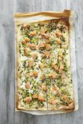 Tarte flambee with salmon trout and spring onions Stock Photos