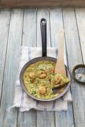 Prawn omelette with herbs Stock Photos