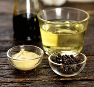 Dijon mustard, peppercorns, white wine vinegar and balsamic vinegar Stock Photos