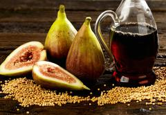 Mustard seeds, figs and vinegar Stock Photos