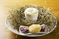 A cup of pumpkin foam soup with poppyseed oil in a nest of hay Stock Photos
