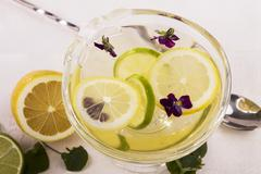 Lemon jelly with violets Stock Photos
