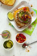 Chicken burger with relish and a drink Stock Photos