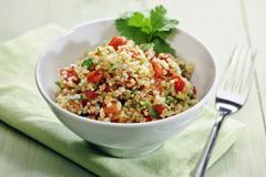Tablouleh (bulgur salad with tomatoes, mint and parsley, Lebanon) Stock Photos